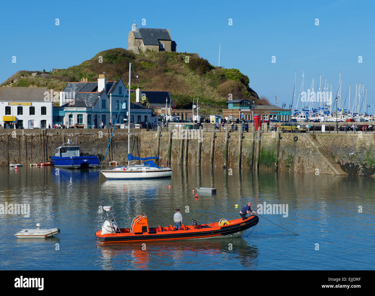 Inflatable boat in the harbour, Ilfracombe, Devon, England UK - Stock Image