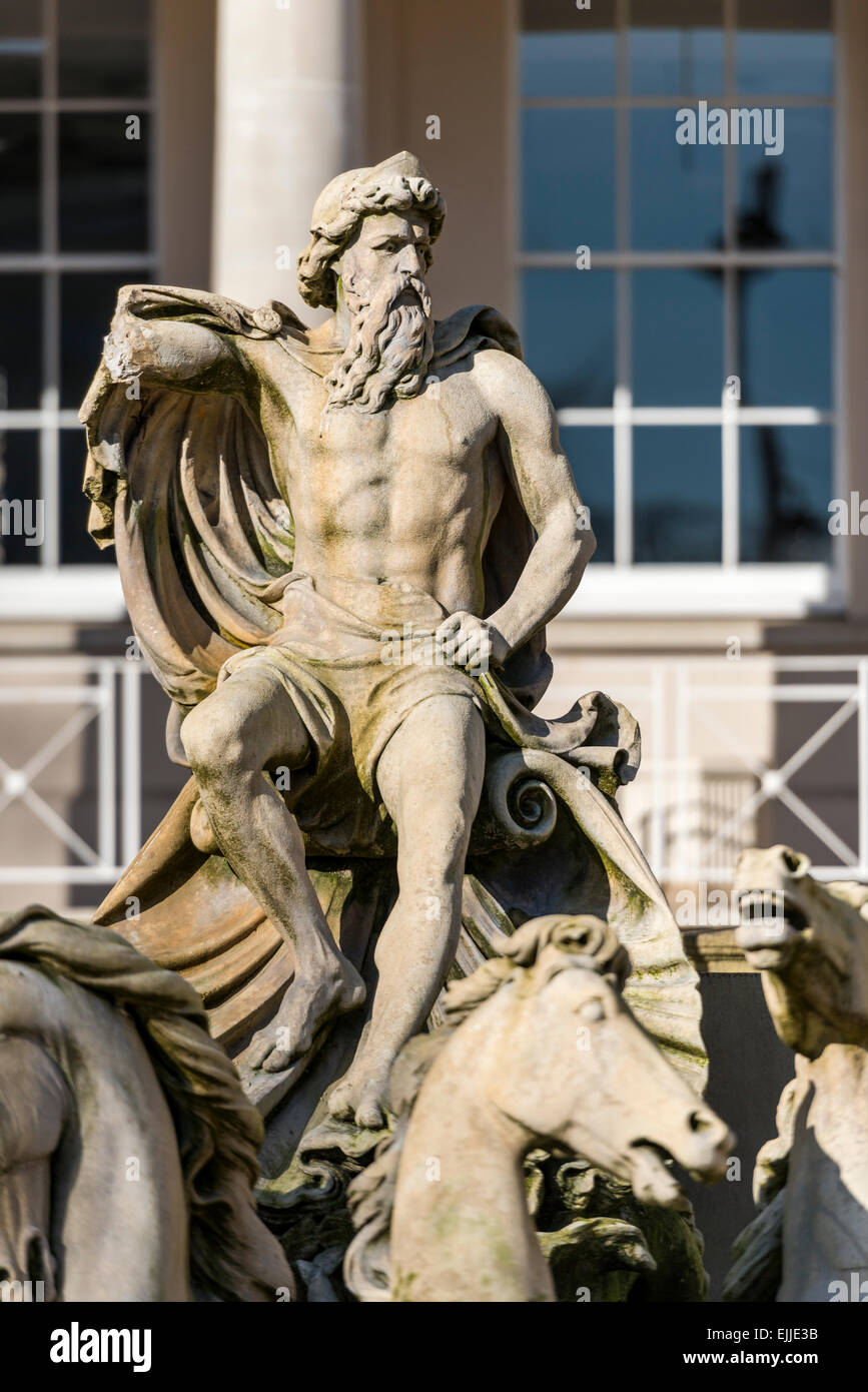 The Neptune Fountain in Cheltenham is a local landmark modeled on the Trevi Fountain in Rome showing sea god Neptune - Stock Image