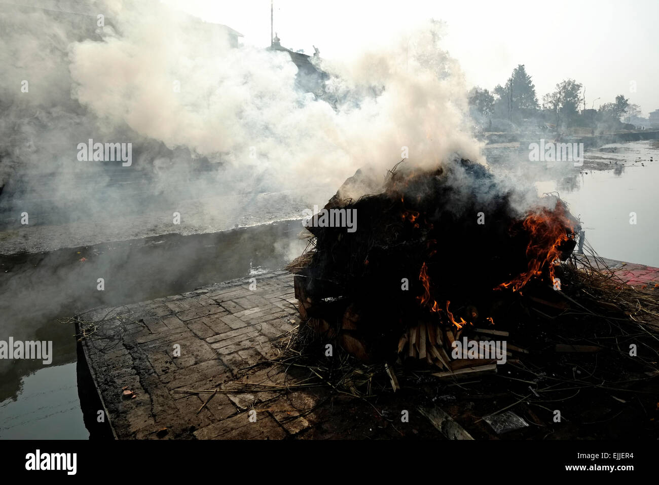 Cremation of dead people taking place at Pashupatinath Temple a Hindu shrine and one of the greatest Shiva sites - Stock Image
