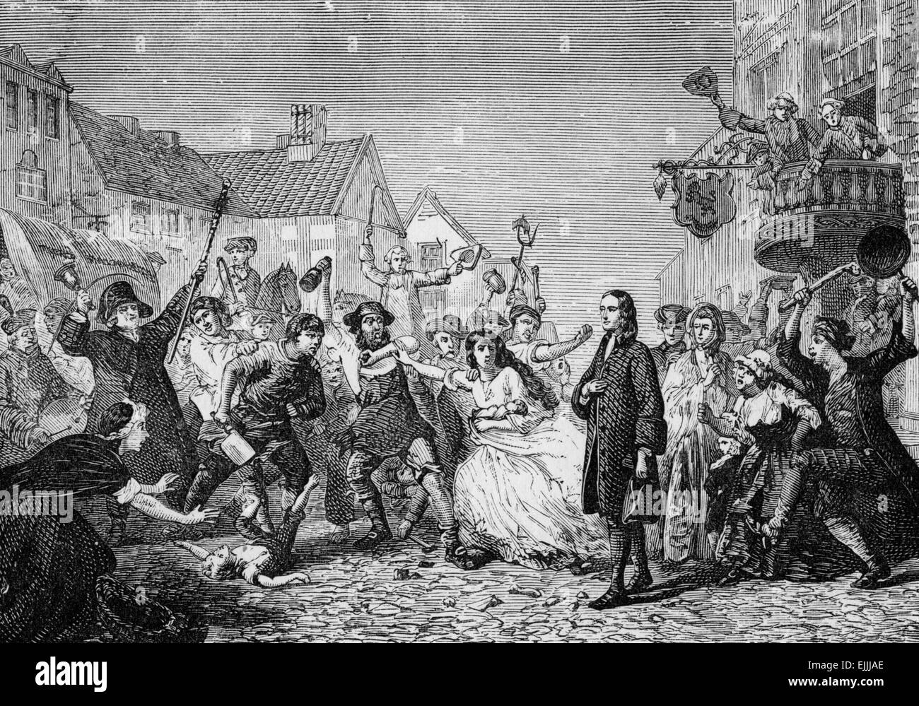 John Wesley in the midst of the riots of 1743 in Wednesbury, England,when local people tried to force him to stop - Stock Image