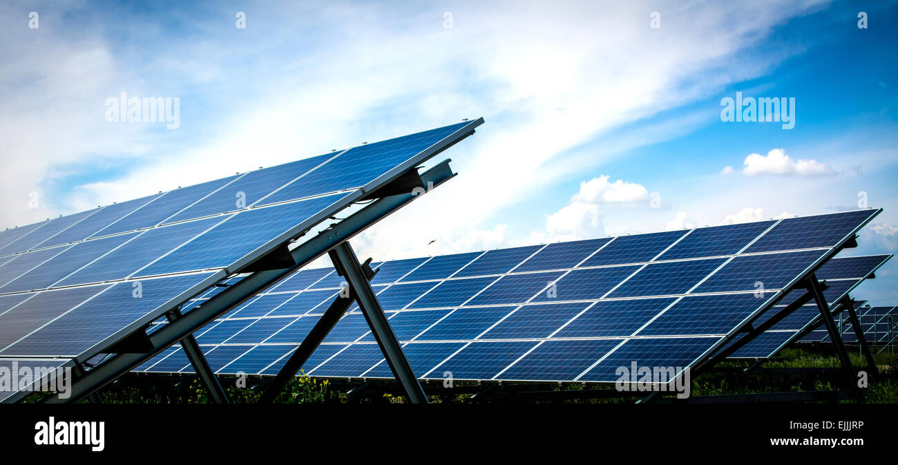 Solar energy panels with blue sky. - Stock Image