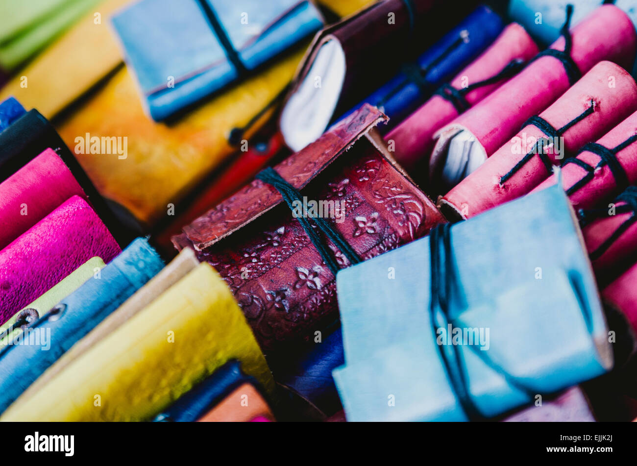 Colourful leather notebooks on an Amsterdam market stall. - Stock Image