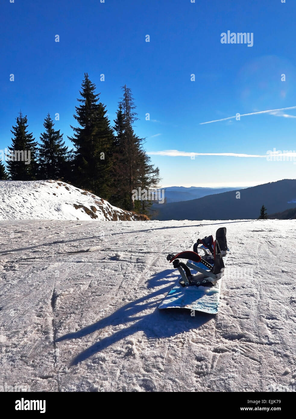 Winter sports. Snowboard on snow ski slope. - Stock Image