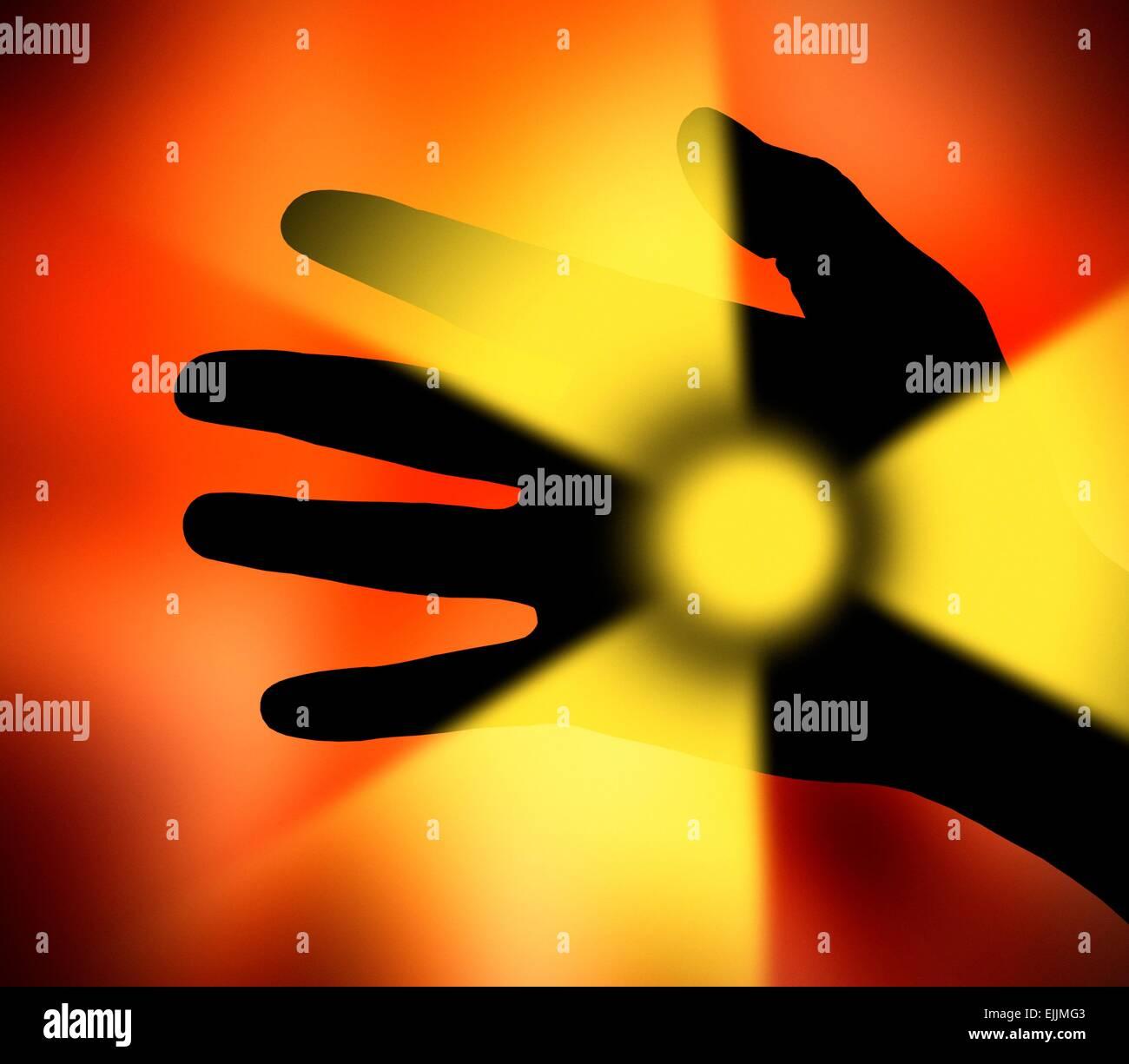Hand and radiation symbol, computer artwork. - Stock Image
