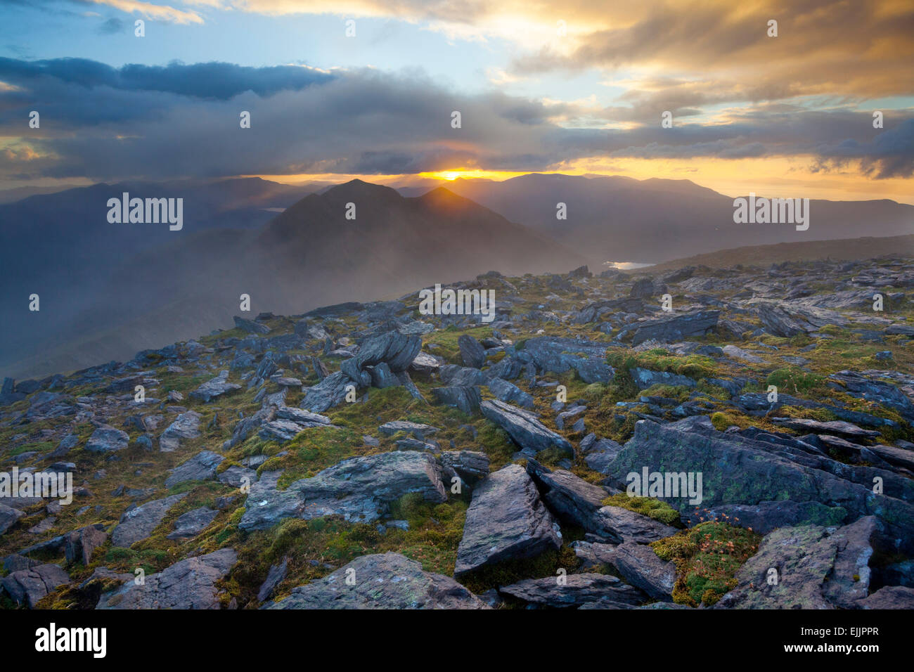 Sunset over Caher, Ireland's third highest mountain, from Carrauntoohil, MacGillycuddy's Reeks, County Kerry, - Stock Image