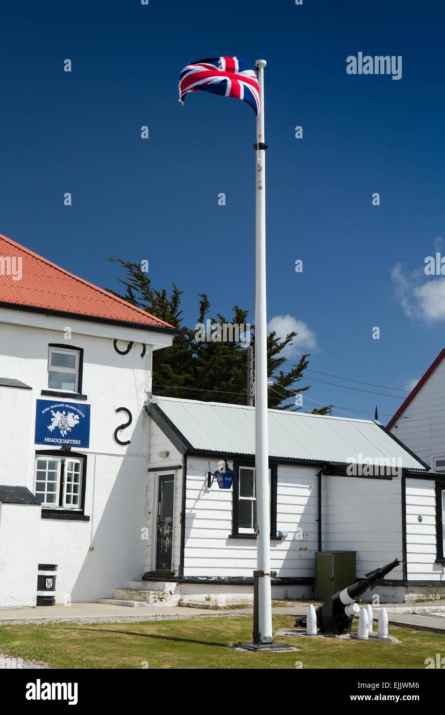 Falklands, Port Stanley, union jack flag flying outside Royal Falklands Islands Police Force HQ - Stock Image