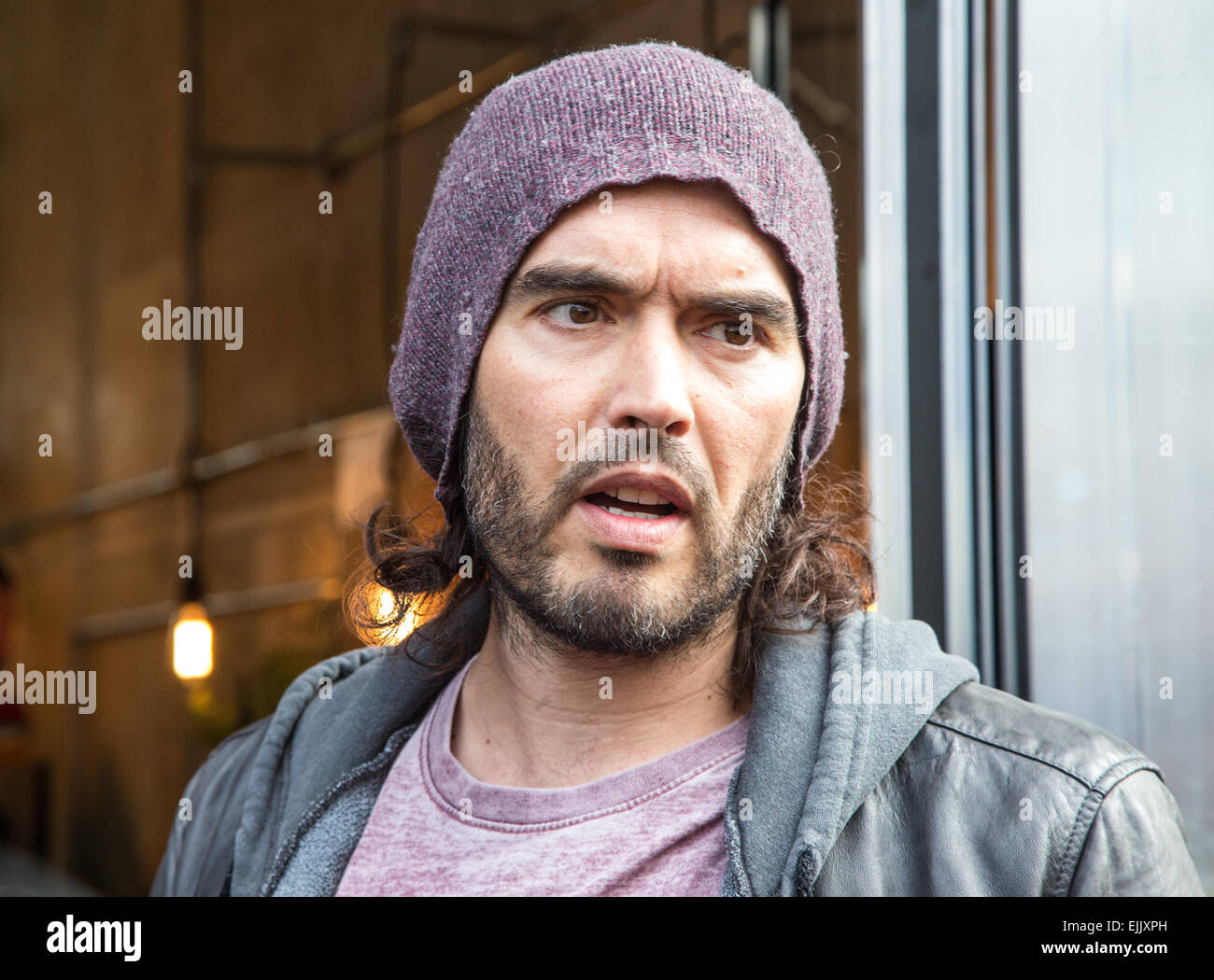 Russell Brand outside the Trew Era community cafe in Hoxton  funded using money from the sales of his book 'Revolution' - Stock Image