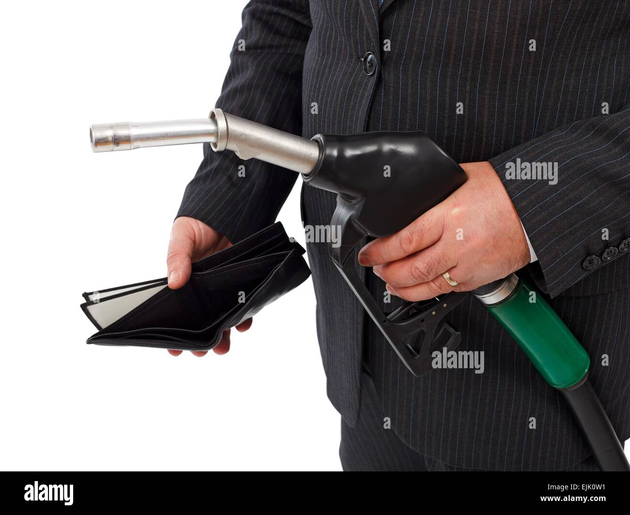 Man's hand holding gas nozzle and empty wallet. Concept of expensive gasoline and lack of money Stock Photo