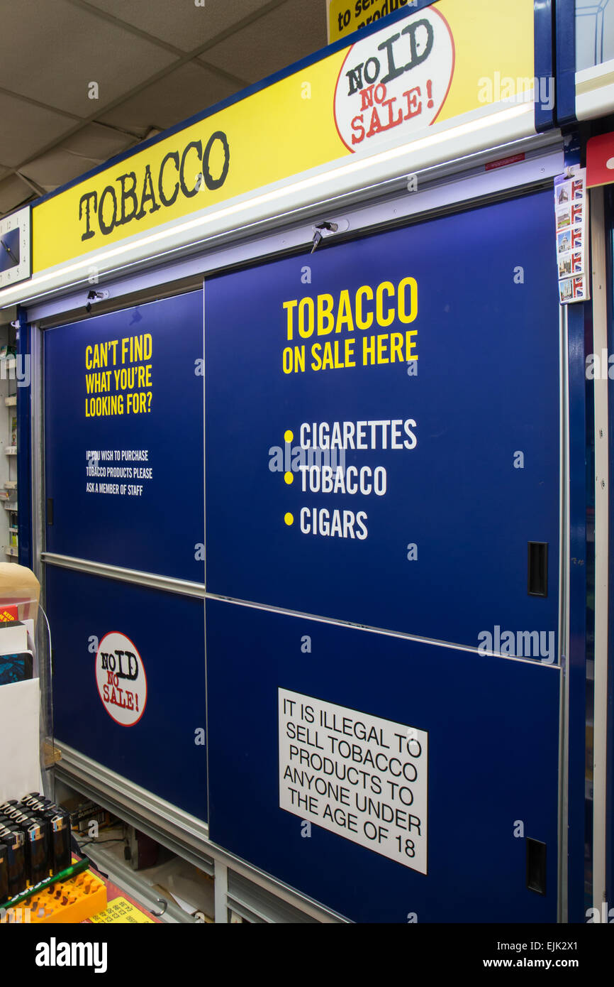 tobacco gantry in a small shop after the display ban - Stock Image