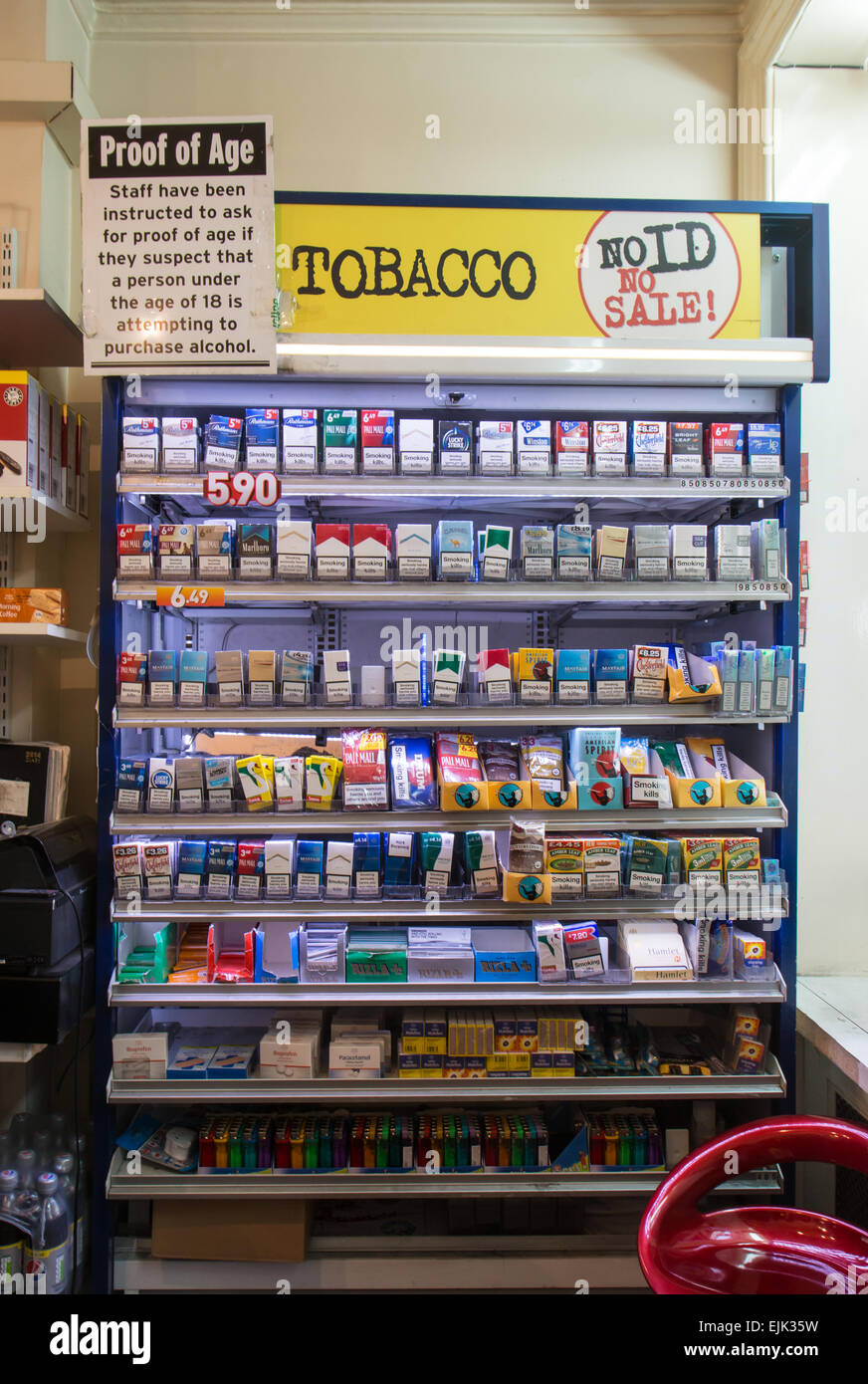 tobacco gantry in a small shop before the display ban - Stock Image
