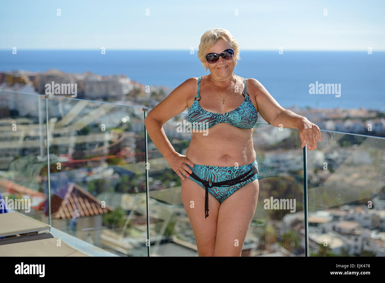 Portrait of senior woman on Los Gigantes coast landscape background below  away 3c613d2f6