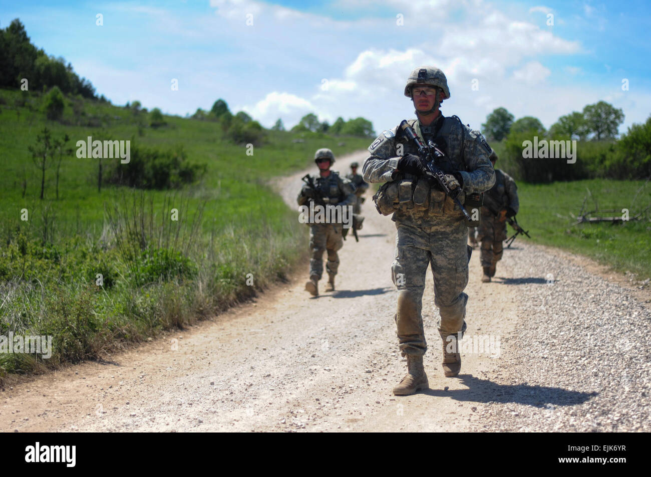 U.S. Army Staff Sgt. Nathan A. Harrison along with paratroopers assigned to Battle Company, 2nd Battalion, 503rd Stock Photo