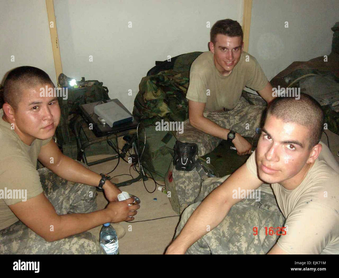 Spc. McGinnis then Pfc. with buddies Pfcs. Raymond Thomas and Edmond Leaveck, following a day of vigorous training - Stock Image