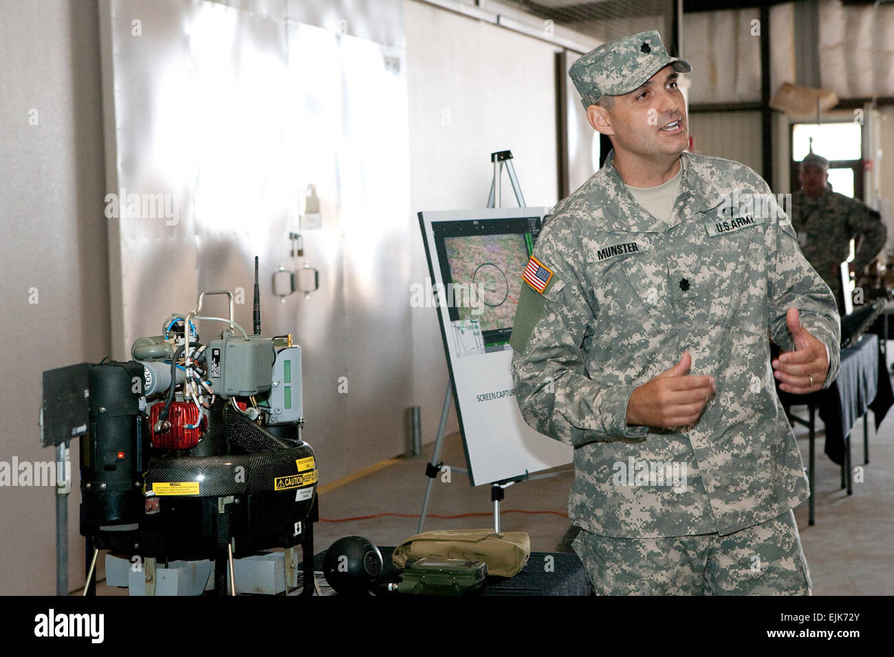 LTC Matt Munster fields questions about the Class I Unmanned Aerial Vehicle UAV at Limited User Test Visitor Day - Stock Image