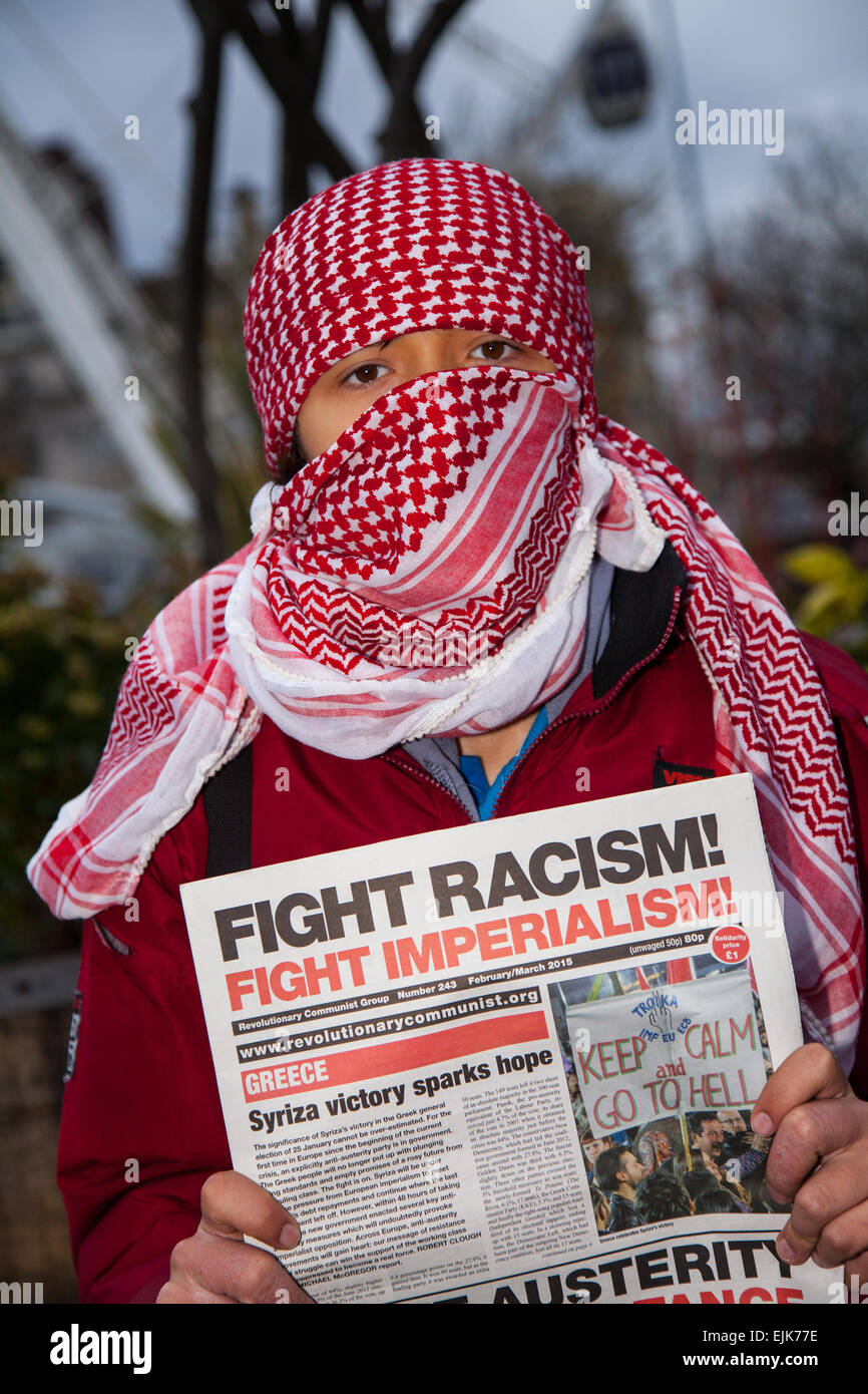 Scarves over the face at Manchester, UK 28th March, 2015. Combined National Front and White Pride Demo in Piccadilly. - Stock Image