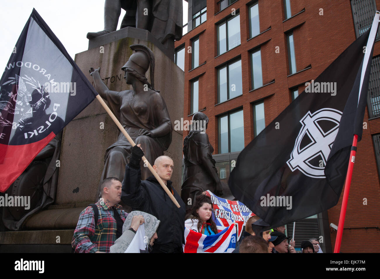 Manchester, UK 28th March, 2015. Far right demonstrators with flags & banners at the National Front and White - Stock Image