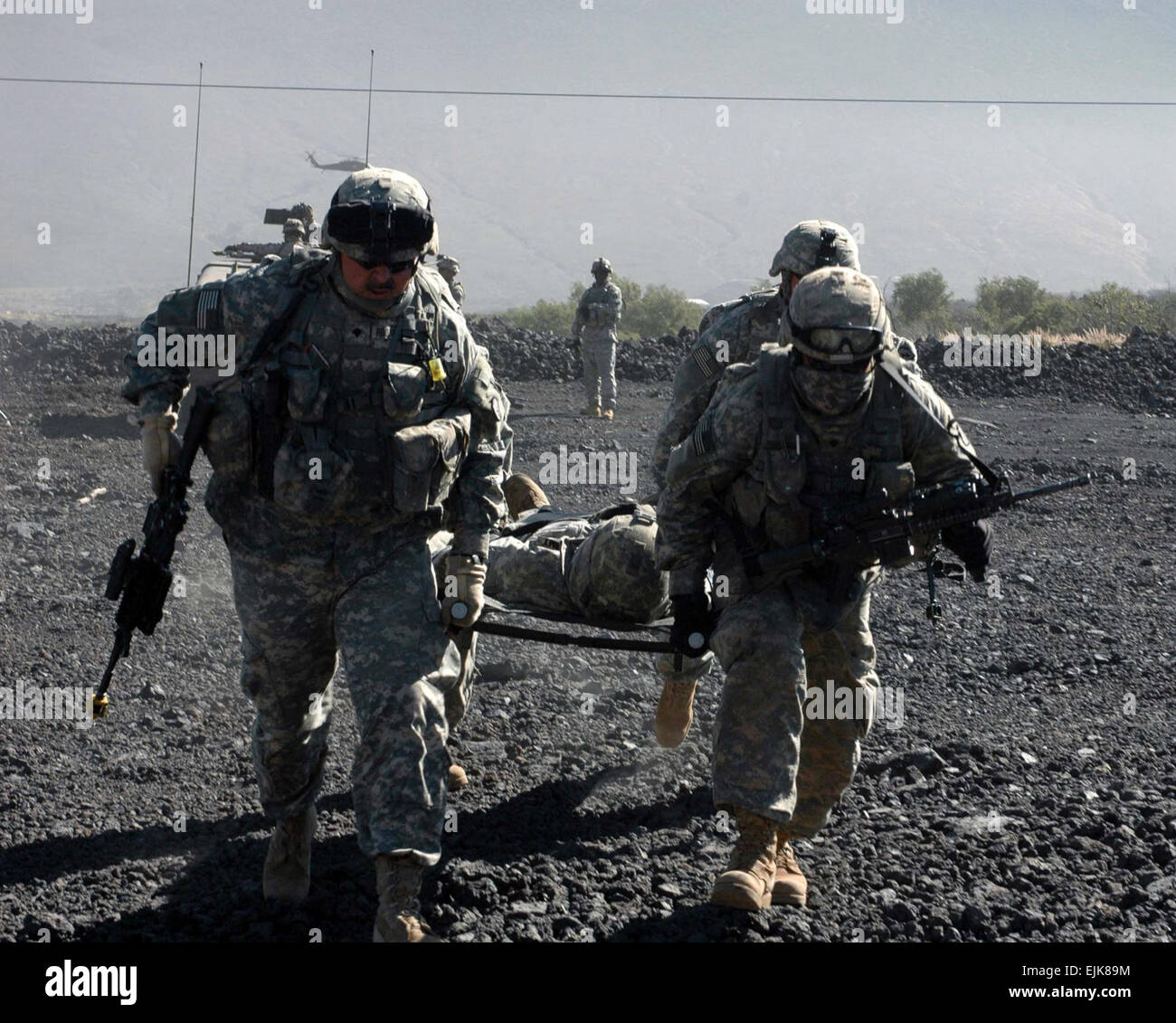 Soldiers from 3rd Infantry Brigade Combat Team, 25th Infantry Division, carry a fellow Soldier on a litter during - Stock Image