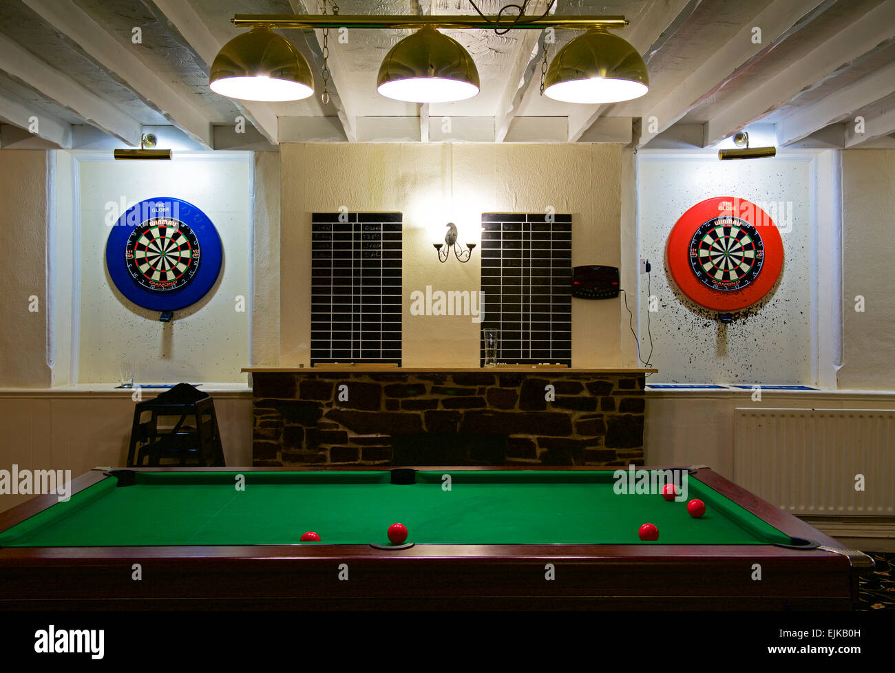 Dartboards and pool table in pub, England, UK - Stock Image