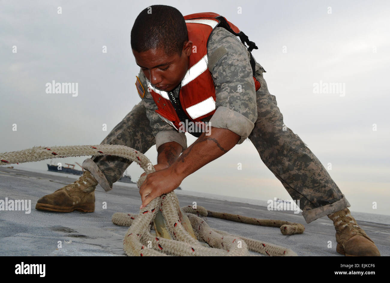 Pfc. Emmanuel Lopez, a watercraft operator assigned to the 331st Transportation Company, 10th Transportation Battalion, - Stock Image