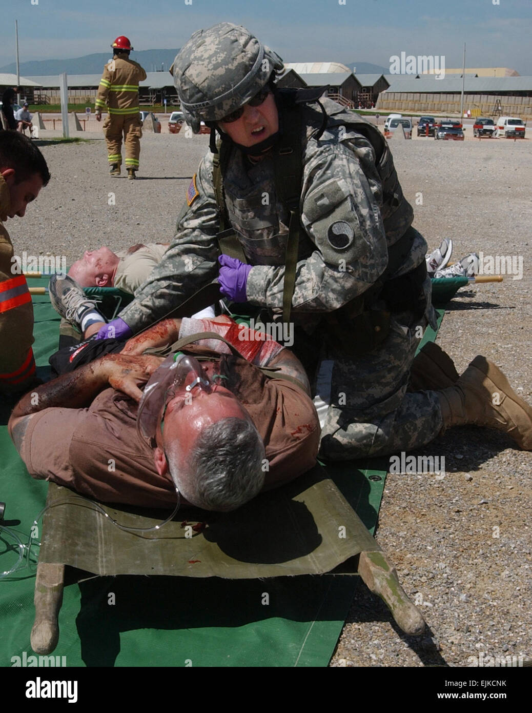 Sgt. Carolyn Gallagher, a reservist attached to the 29th infantry Division, yells for help during a mass casualty Stock Photo