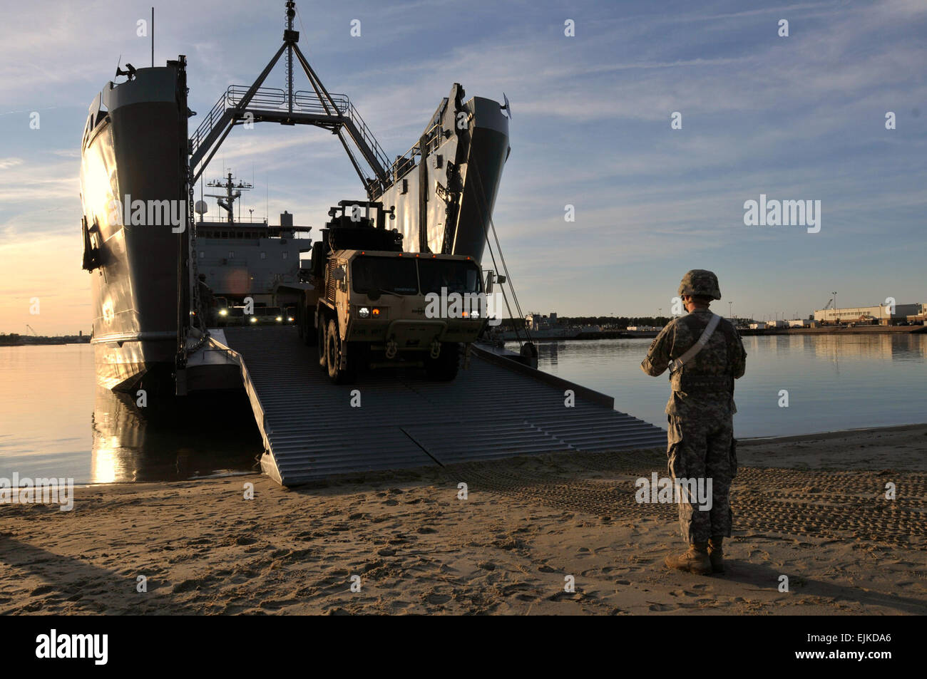 Waterborne Soldiers of the 10th Transportation Battalion spend the morning of Feb. 7 loading vehicles on board the - Stock Image