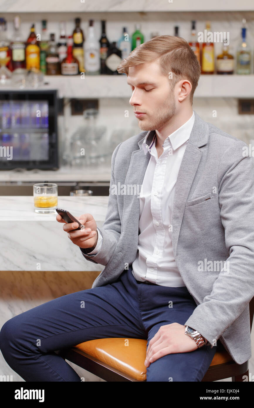 Waiting for friends in the bar - Stock Image