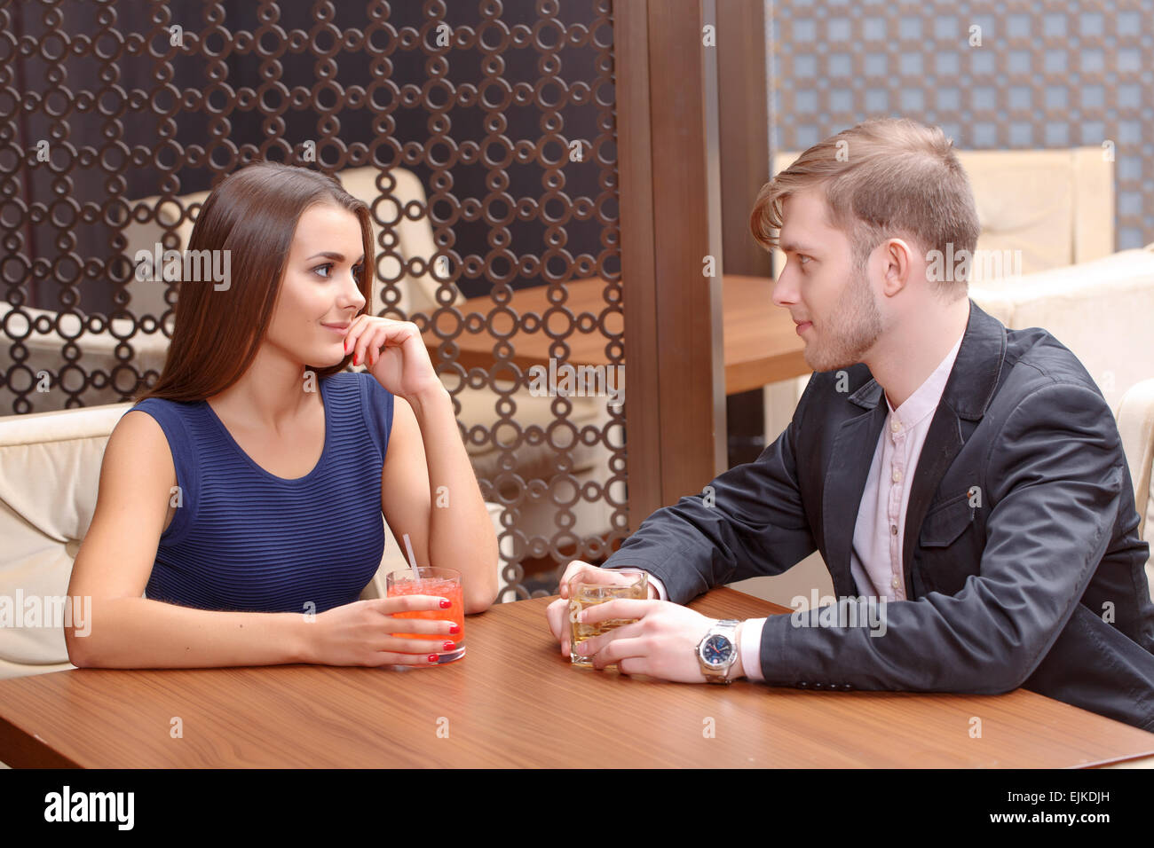 Couple sits in the cafe - Stock Image