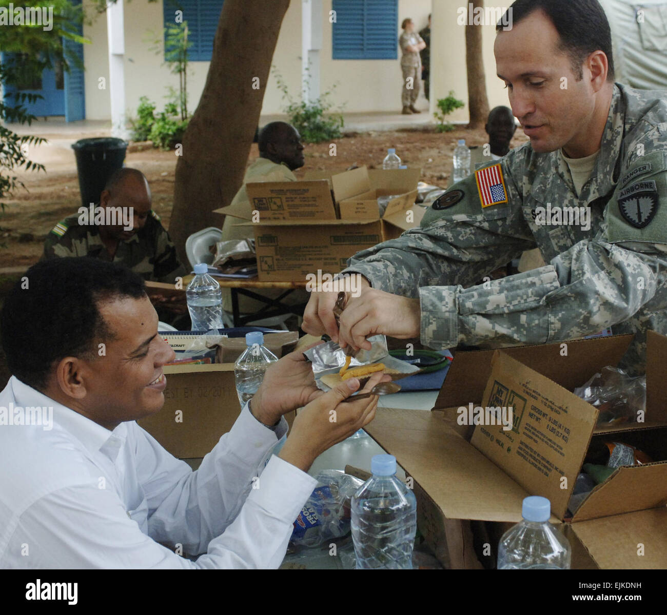 U.S. Army Lt. Col. David Sigmund, Special Operations Command-Europe, Psychological Operations, assists a national Stock Photo