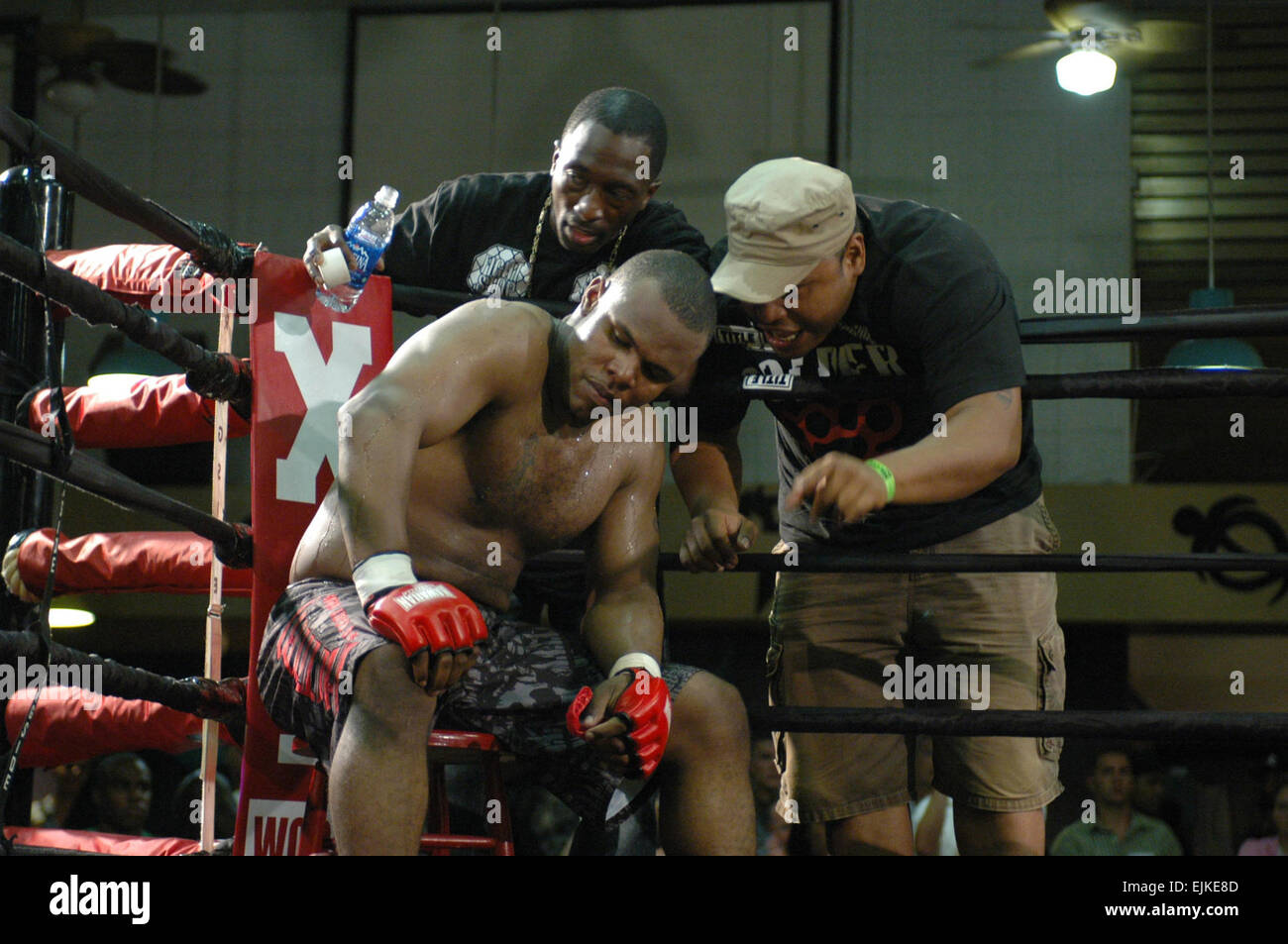 Sgt. 1st Class Anthony Chenault, 185-pound competitor, listens to guidance from his coaches during the main event - Stock Image