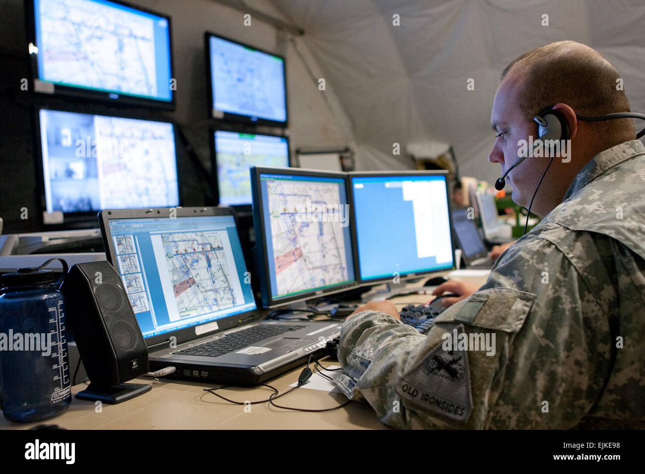 Soldiers monitor input from the Tactical Operations Center TOC at Early Infantry Brigade Combat Team E-IBCT Limited - Stock Image