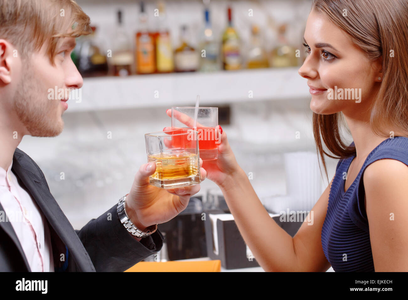 Couple has a drink in the bar - Stock Image
