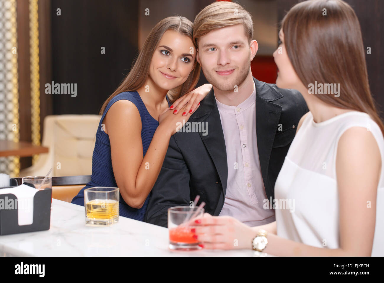Meeting with friends in the bar - Stock Image