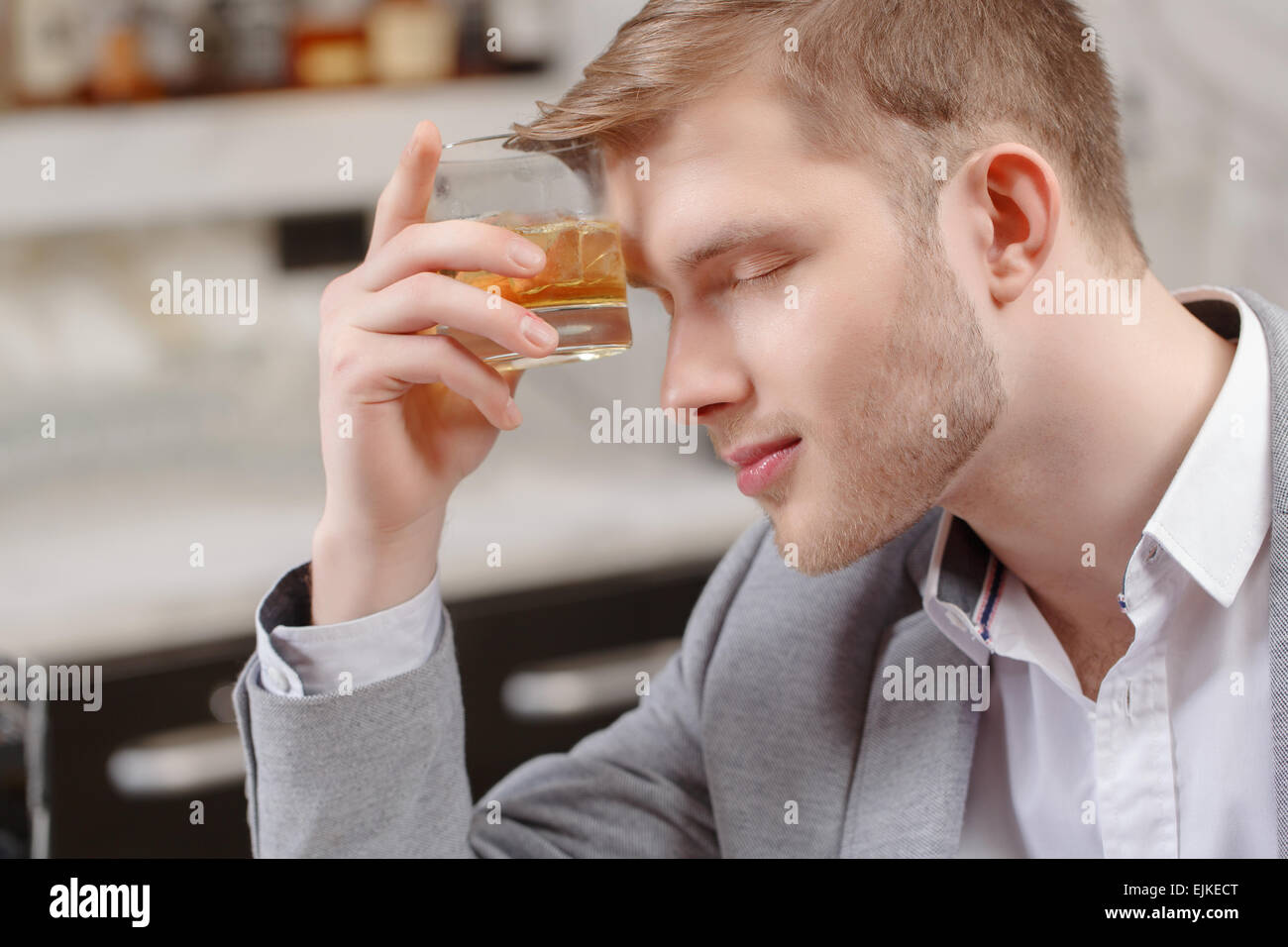 Man with a cocktail in the bar - Stock Image