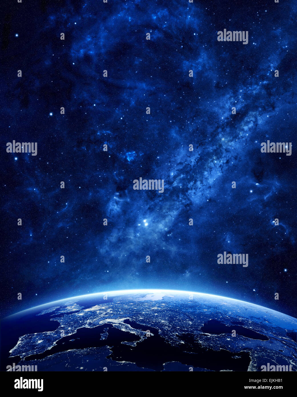 Earth at night as seen from space with blue, glowing atmosphere and space at the top. Perfect for illustrations. - Stock Image