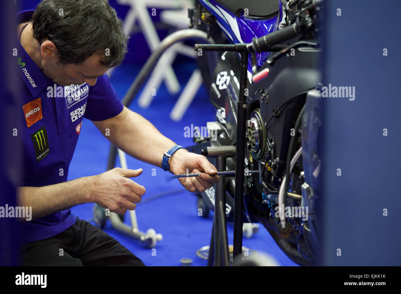 Losail Circuit, Qatar 28th March 2015, a team mechanic prepares the bike of Jorge Lorenzo during qualifying for - Stock Image