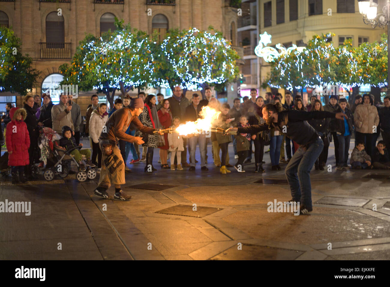 CORDOBA - JAN 4: A street entertainer playing with fire torch in front of a large crowd of people, on January 4, - Stock Image