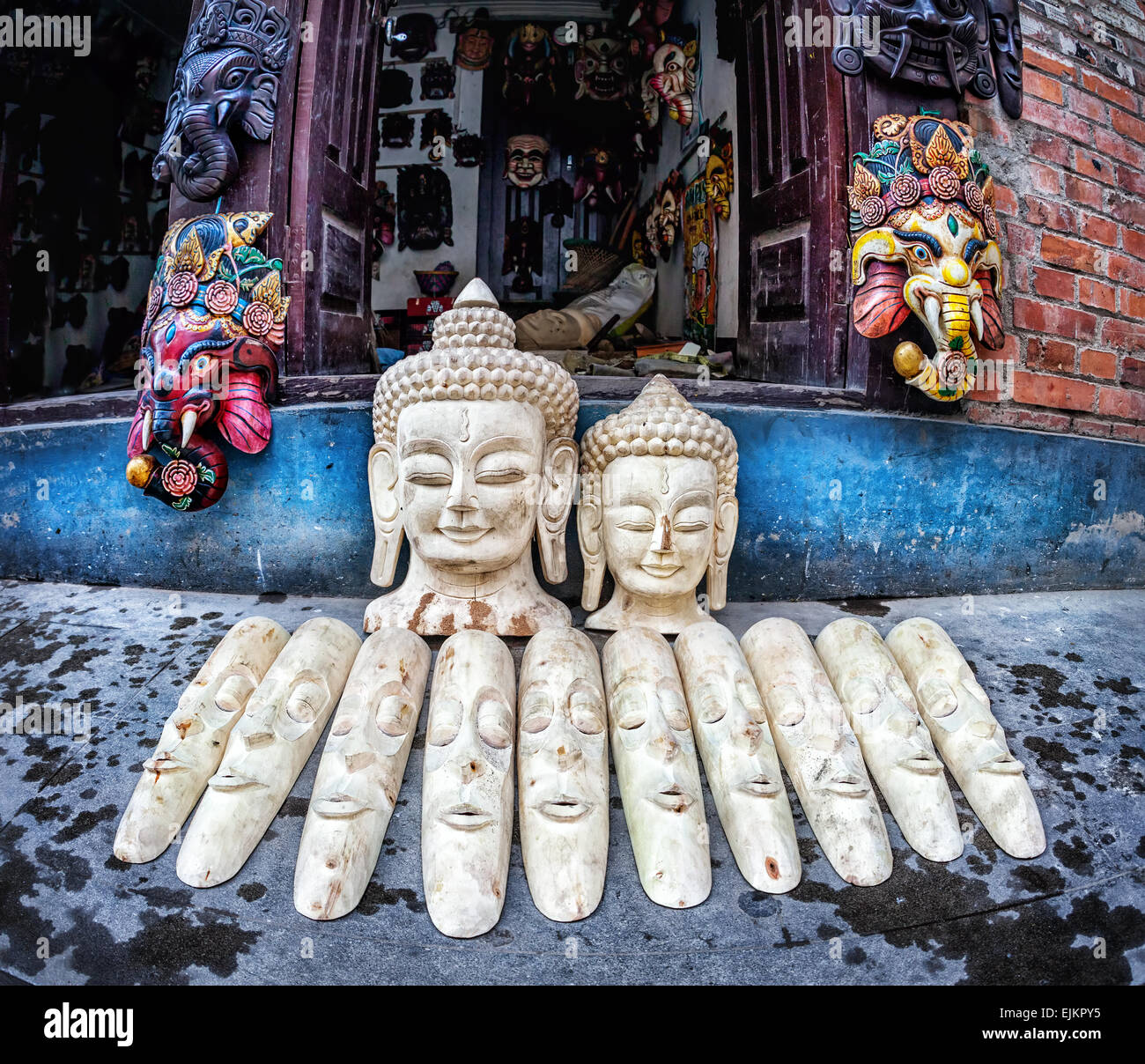 Buddha and Ganesh heads and other souvenir masks in the shop of Patan, Kathmandu valley, Nepal - Stock Image