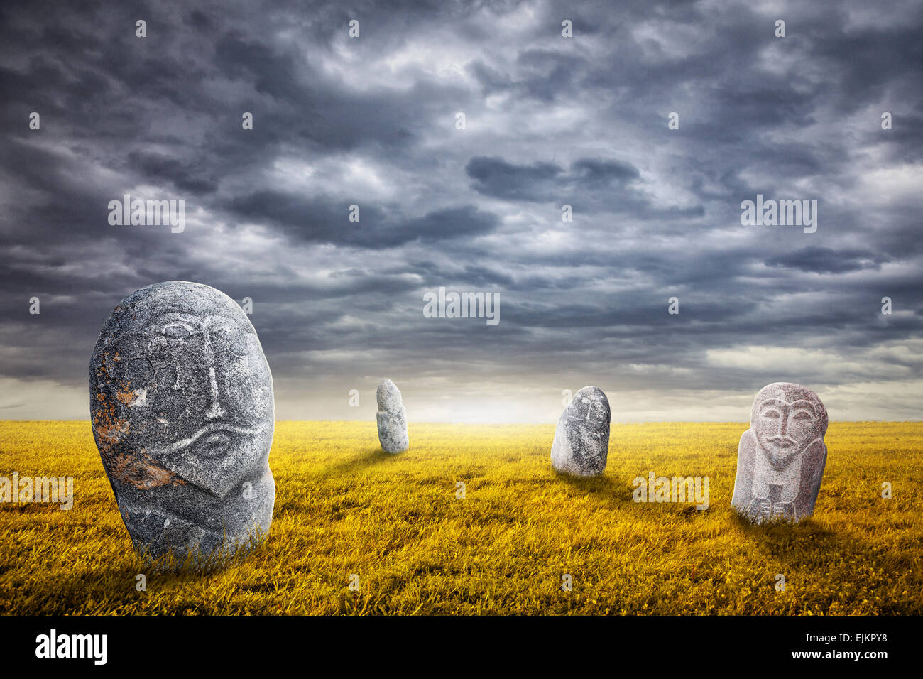 Ancient balbal statues on the field at overcast sky in central Asia - Stock Image