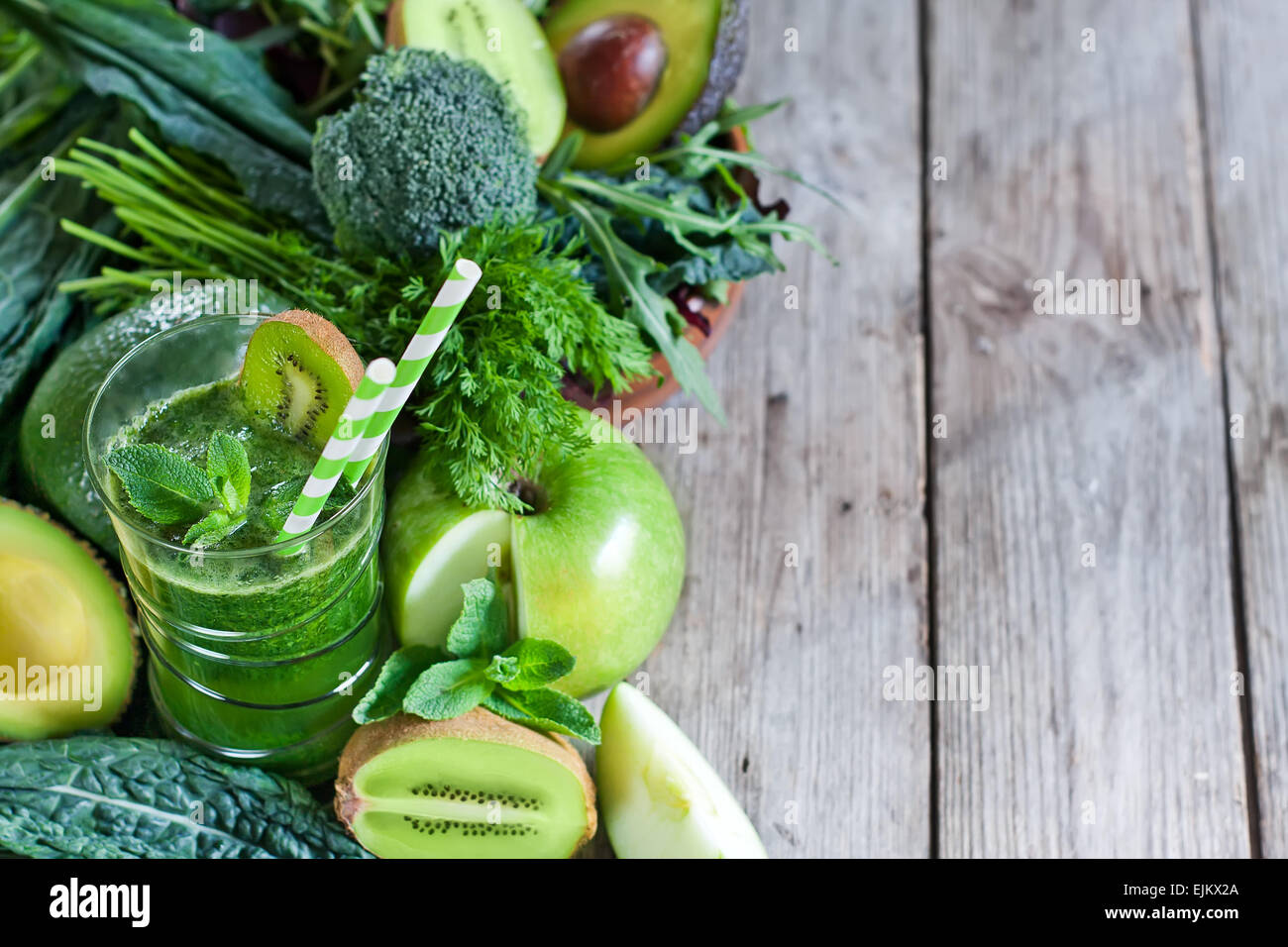 Green detox smoothie with raw vegetables and fruits. Copyspace background. Stock Photo