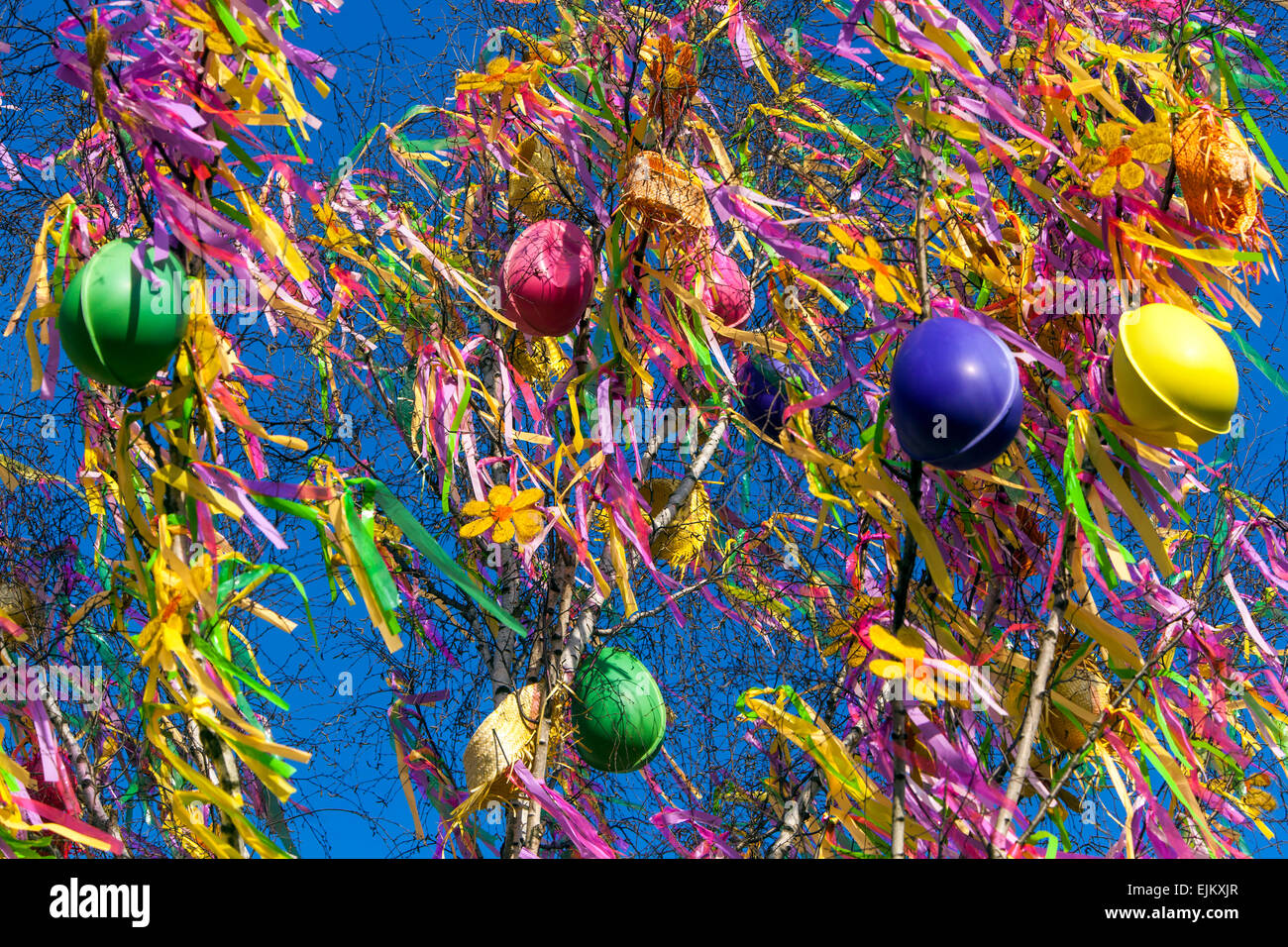 A colorfully decorated tree, Easter eggs, traditions, holidays, Old Town Square Prague Czech Republic - Stock Image