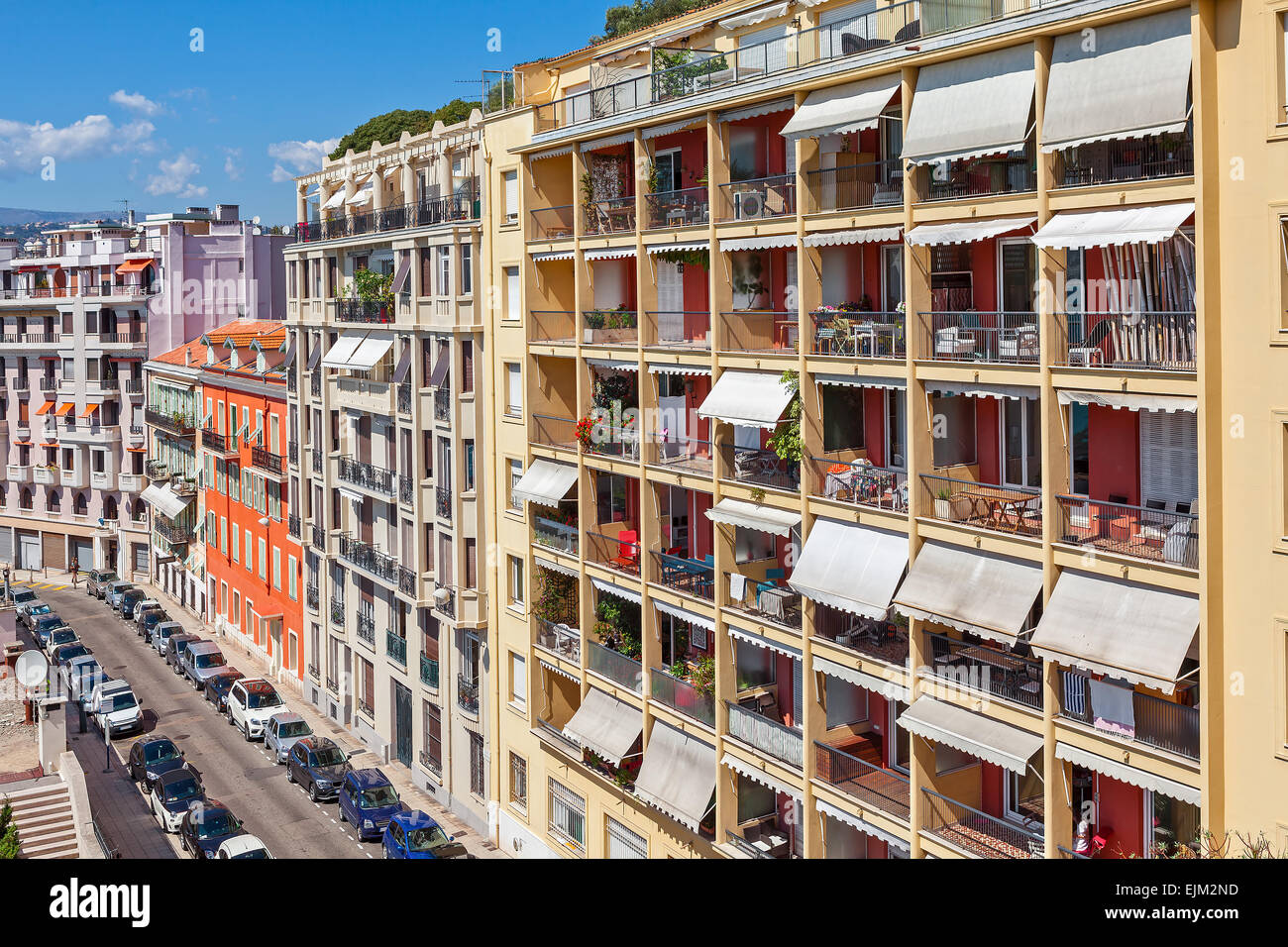 View of colorful apartment buildings in Nice, France. - Stock Image