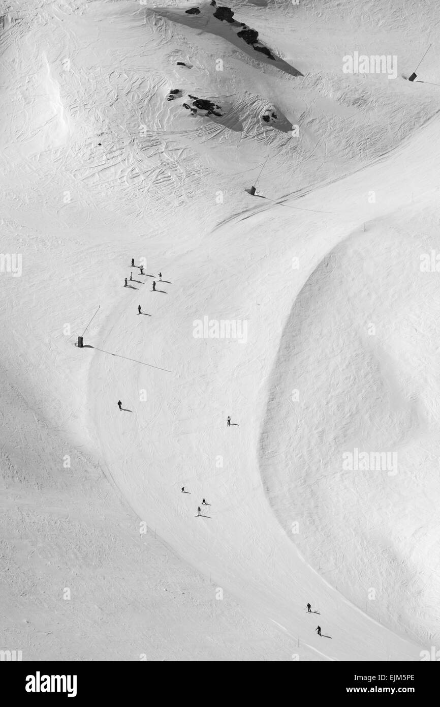 skiers heading down the piste - Stock Image