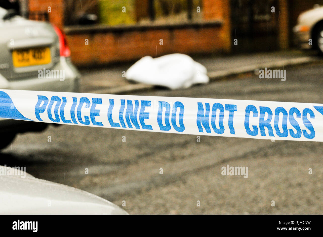 Belfast, Northern Ireland. 29 Mar 2015 - Police close off Brae Hill Park after a man, 50, sustained leg and head - Stock Image