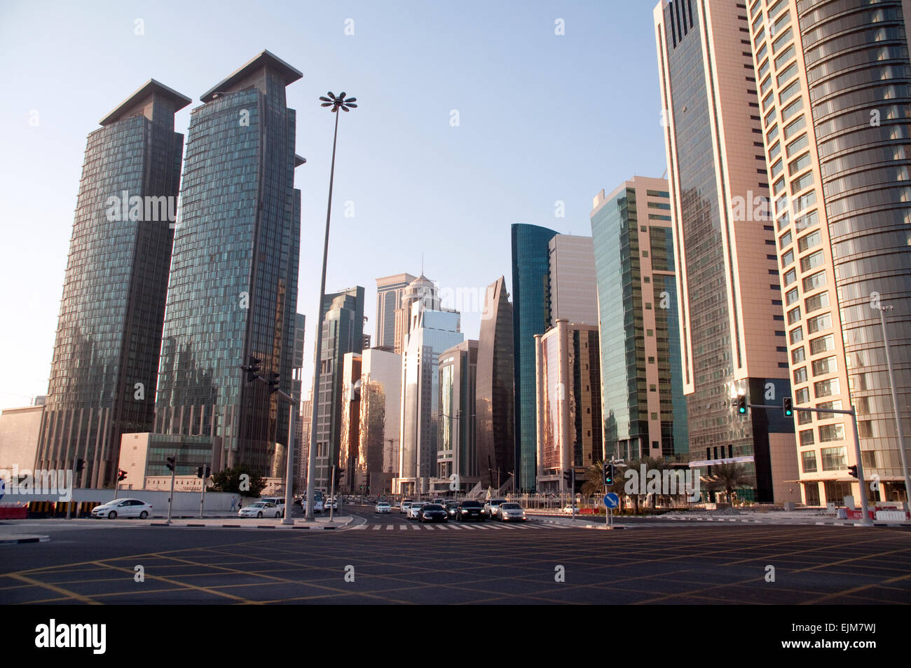 A cluster of residential and office towers on a main avenue in the city of Doha, in the Middle Eastern Gulf nation - Stock Image