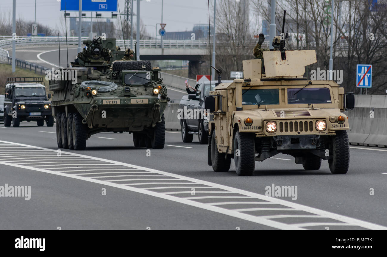 us army convoy armored vehicle stryker and humvee going across czech republic stock image