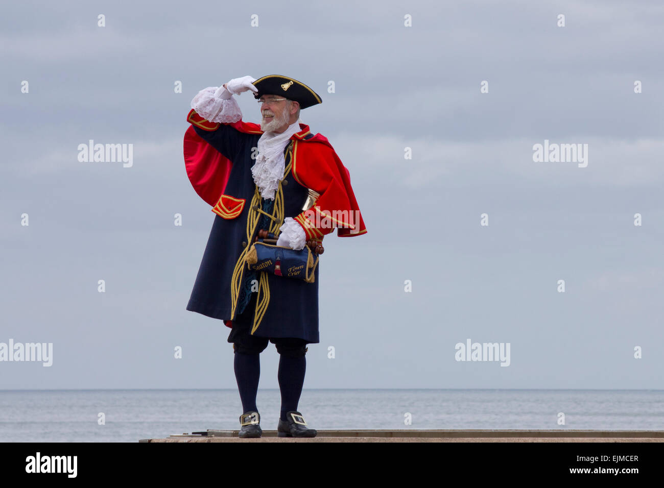Town Crier. Town crier in traditional costume in Seaton, Devon, England, UK. - Stock Image