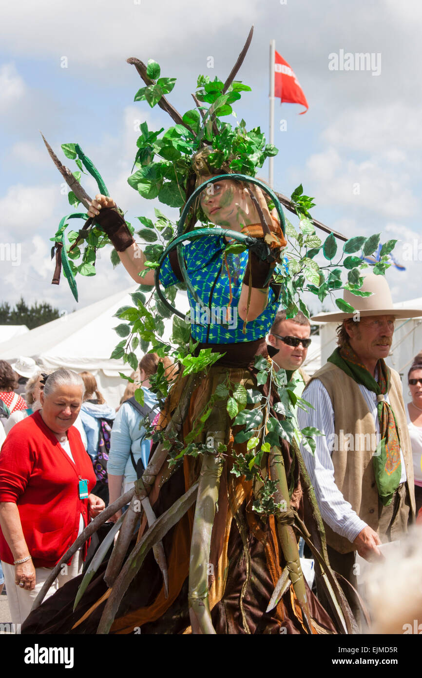 Street performer dressed as a green woman walking on stilts at the Royal Cornwall Show in 2008 - Stock Image