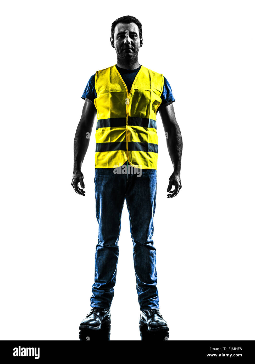 one man standing in yellow safety vest silhouette isolated in white background - Stock Image