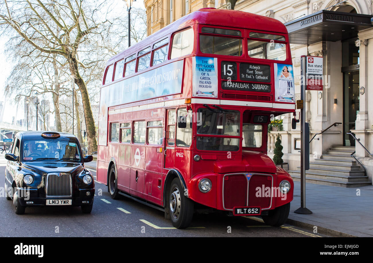 Red double-decker bus and London taxi, London - Stock Image