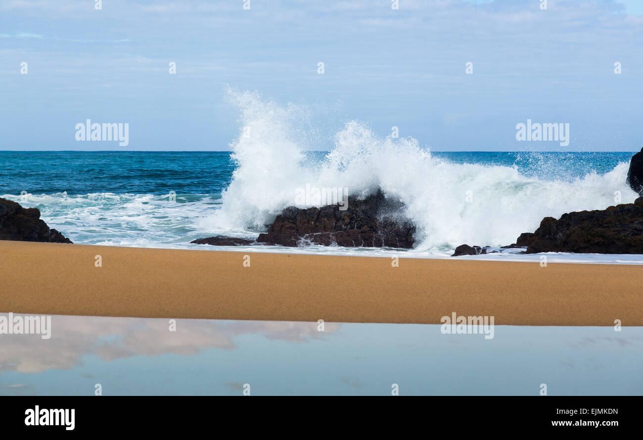 Waves crash onto Lumahai beach in background on Kauai Hawaii - Stock Image